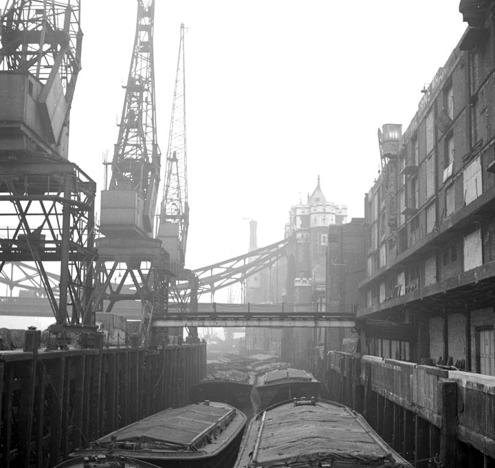 The Long Memory-Barges unloading at St. Katherine Dock
