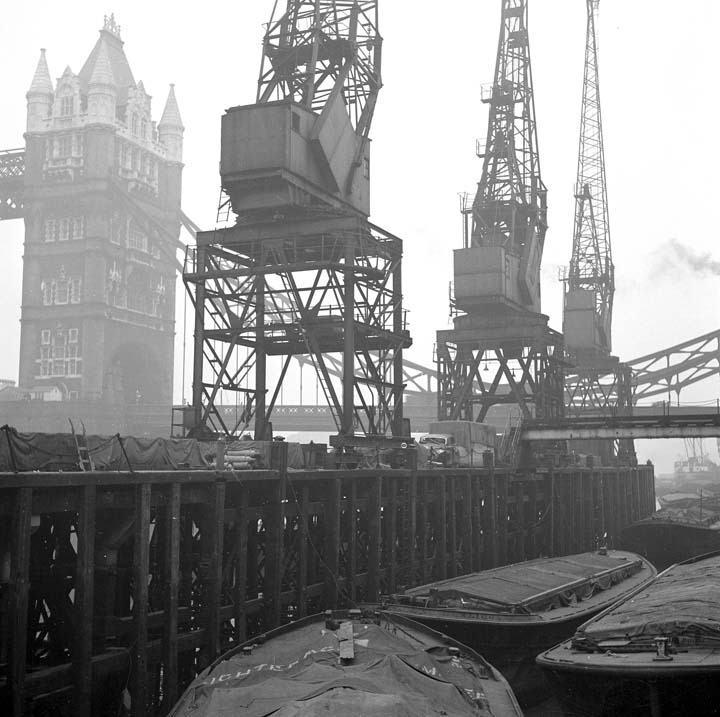 The Long Memory-Tower Bridge with cranes from St. Katherine Docks.