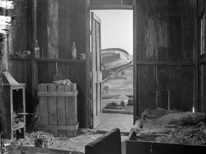 The Long Memory-Interior of Jackson's hut, a kindly old hermit from whom he rents the barge
